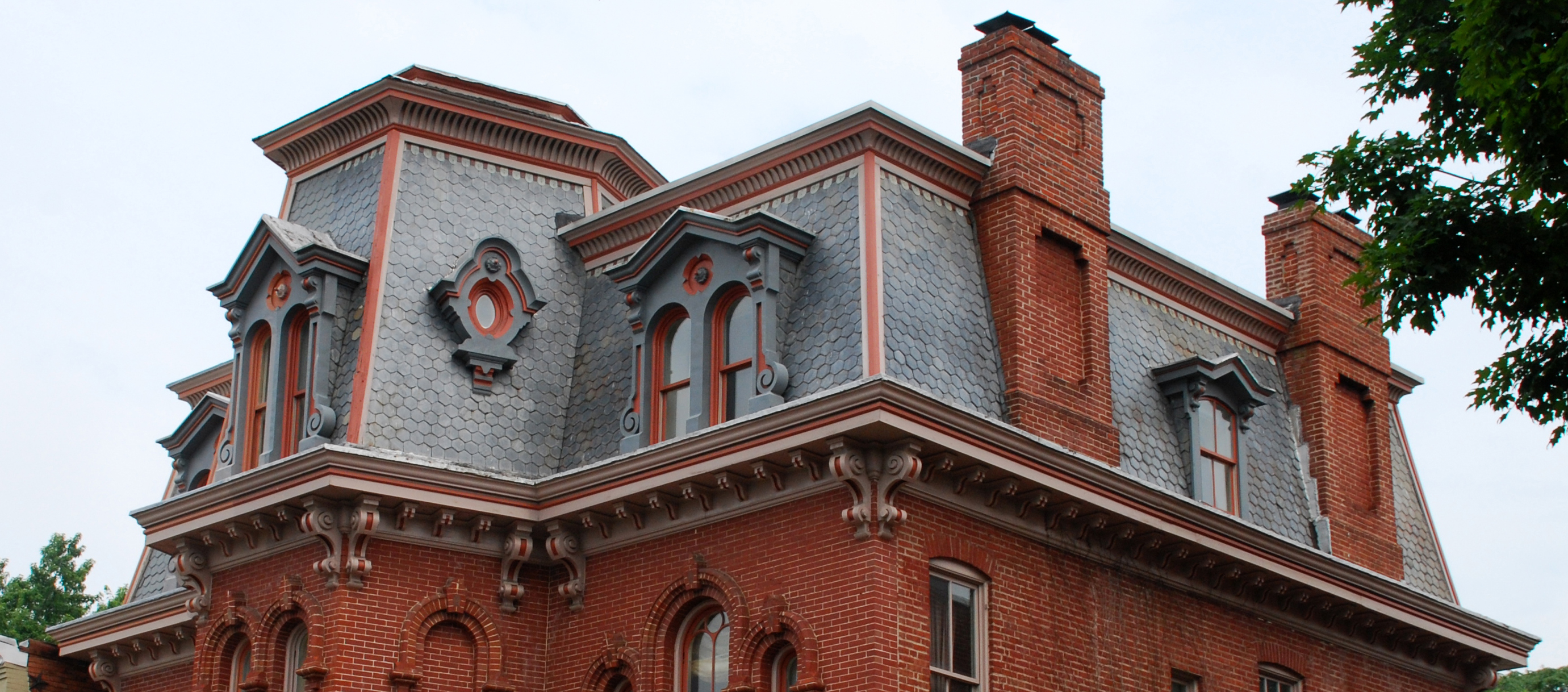 Field guide to georgetown houses the early victorian for What is a mansard roof